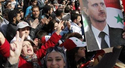 Supporters of Syria's President Bashar al-Assad attend a rally at Umayyad square in Damascus March 15, 2012. REUTERS/Khaled al-Hariri