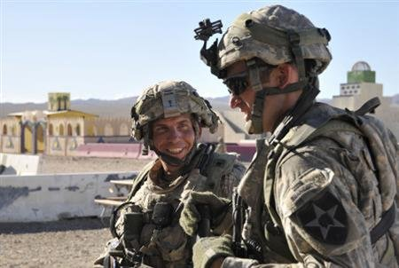 Staff Sgt. Robert Bales, (L) 1st platoon sergeant, Blackhorse Company, 2nd Battalion, 3rd Infantry Regiment, 3rd Stryker Brigade Combat Team, 2nd Infantry Division, is seen during an exercise at the National Training Center in Fort Irwin, California, in this August 23, 2011 DVIDS handout photo. REUTERS/Department of Defence/Spc.