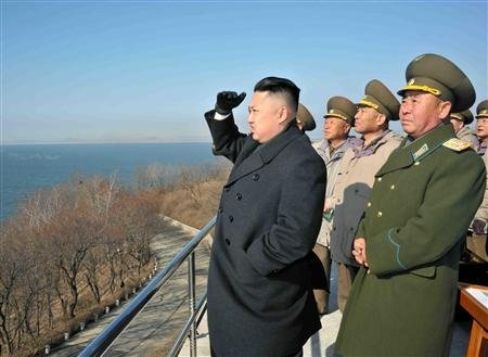 North Korean leader Kim Jong-Un (L) inspects a combined strike drill of the three services of the Korean People's Army in an undisclosed location, in this undated picture released by the North's KCNA in Pyongyang March 15, 2012. REUTERS/KCNA