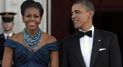 President Barack Obama and first lady Michelle Obama wait to welcome Britain's Prime Minister David Cameron and his wife Samantha Cameron to the White House prior to a State Dinner, Wednesday, March 14, 2012, in Washington. (AP Photo/Susan Wal