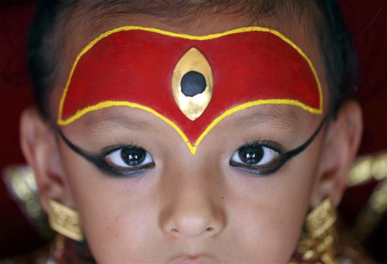Sambeg Shakya, 6, gets ready to play his role as a living god at the Indra Jatra festival in Kathmandu September 16, 2011. Sambeg Shakya was hailed last year by Buddhist priests as Ganesh, or the god of good fortune, since when he has led several processions of Nepal's better-known 'living goddesses', also known as Kumari. The centuries-old ritual, once used by now-toppled kings who thought it would make them stronger, was the climax of the annual Hindu festival of Dasain, which lasts for two weeks and has become a major tourist attraction in Nepal. Sambeg will continue in his supporting role until he is big enough to fit in a chariot pulled by men, after which he must return to real life. Picture taken September 16, 2011. REUTERS/Navesh Chitrakar (NEPAL - Tags: RELIGION SOCIETY POLITICS)