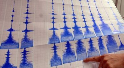 A seismologist points to a graphic showing an earthquake at a monitoring centre in Taipei. Japan issued a tsunami warning on Wednesday after a 6.8 magnitude earthquake struck off its northeastern coast, warning of a wave as high as 50 centimetres (20 inches)