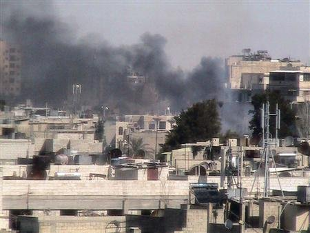 Smoke rises from Bab Sabaa neighbourhood of Homs March 19, 2012. Picture taken March 19, 2012. REUTERS/Shaam News Network/Handout