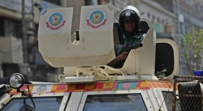 A Bangladeshi policeman stands guard on an armored car during a nationwide strike in Dhaka last week. Seven small bombs have exploded in the Bangladeshi capital, police say, after an opposition supporter is shot dead in clashes ahead of a fourth nationwide strike in eight days