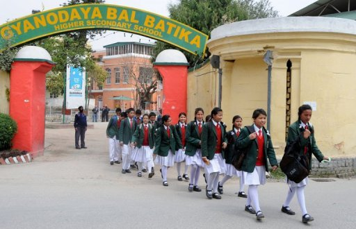 Nepalese Humla children leave their private school to head for home in a suburb of Kathmandu. While their classmates come from the country's wealthiest elite, these children were rescued seven years ago, dirty and sick, from a cowshed on the edge of the capital