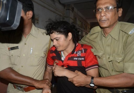 Police escort former Indian athlete Pinki Pramanik to the Barasat district court, north of Kolkata, in June. Pramanik denied on Wednesday raping her former girlfriend who has alleged that she is actually a man