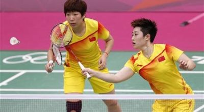 China's Wang Xiaoli and Yu Yang (R) play against South Korea's Jung Kyung-eun and Kim Ha-na during their women's doubles group play stage Group A badminton match during the London 2012 Olympic Games at the Wembley Arena in this July 31, 2012 file photo. REUTERS/Bazuki Muhammad/Files